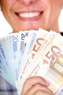 euro notes with big smile in the background - focus is on notes