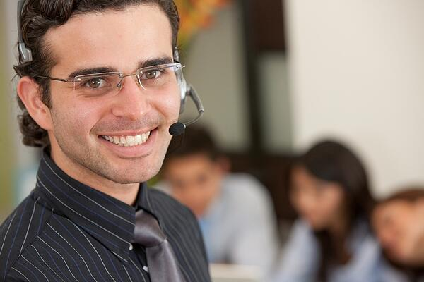 male support operator smiling in an office